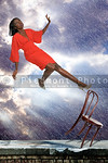 Woman falling off chair