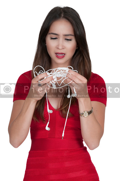 Woman with tangled headphones