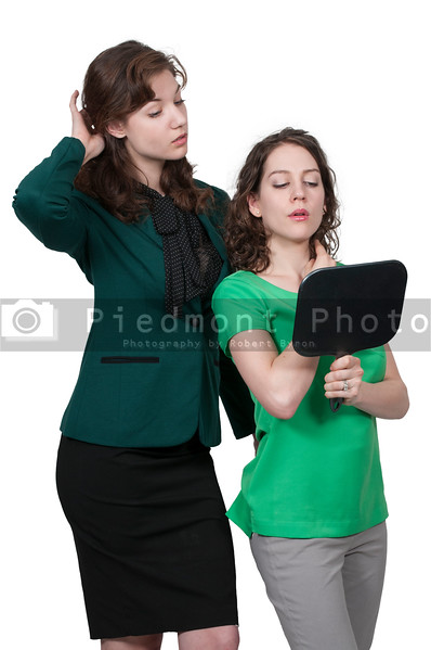 Women looking in a vanity mirror