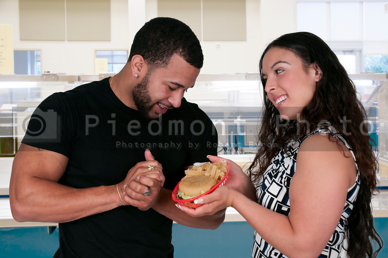 Woman Giving Hamburger to a Man