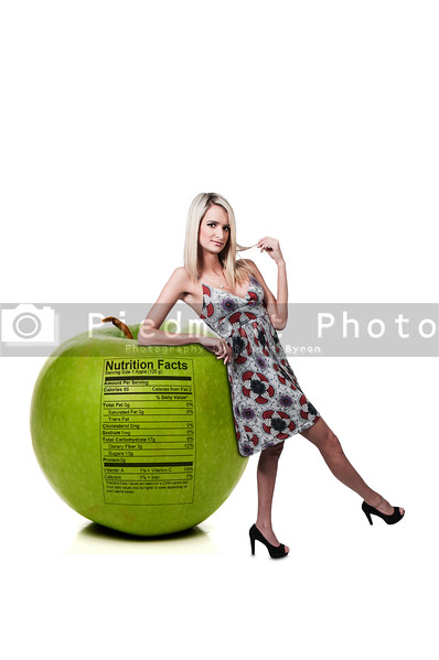 Woman Leaning on Apple with Nutrition Label