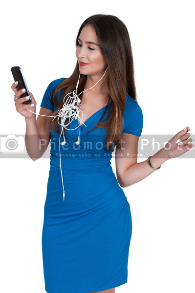 Woman with tangled ear buds