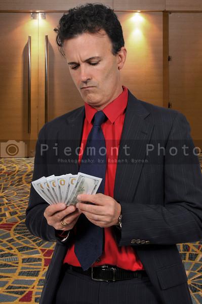 Man Holding 100 Dollar Bills