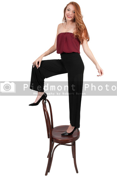 Woman Standing On Chair