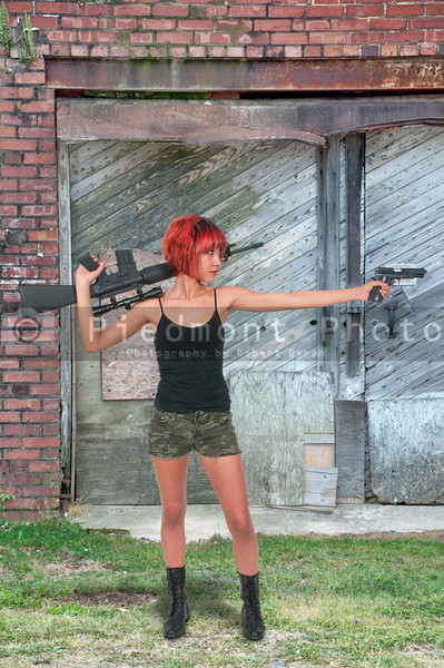 Woman with Assault Rifle and Handgun