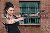 Tattooed Woman with Pistols