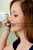Beautiful Teenage Woman Brushing Teeth