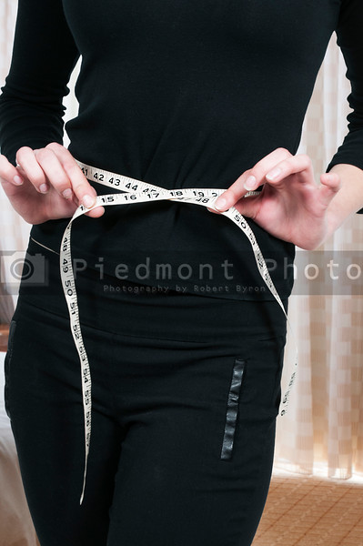 Woman Measuring Her Waist
