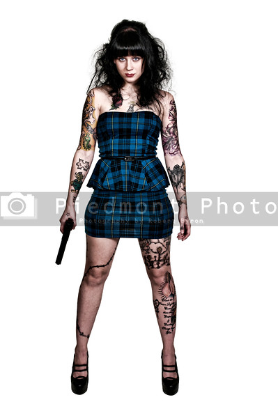 Tattooed Woman with Pistol