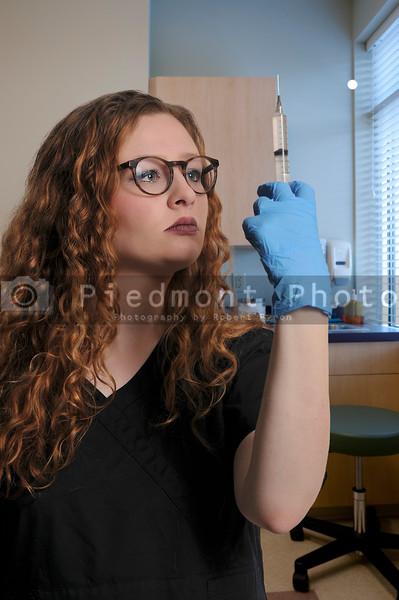 Female Doctor with Syringe