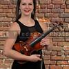 Woman Holding Violin