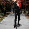 Woman in a vinyl cat suit