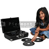 Little girl with vinyl 45 record and player