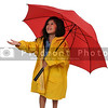 Girl in Raincoat Holding Umbrella