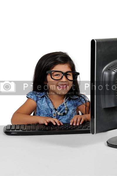 Little Girl Using Computer