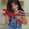 Little girl cutting hair