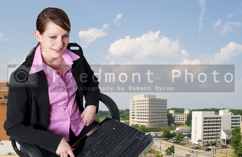 A beautiful computer savvy young woman using a laptop
