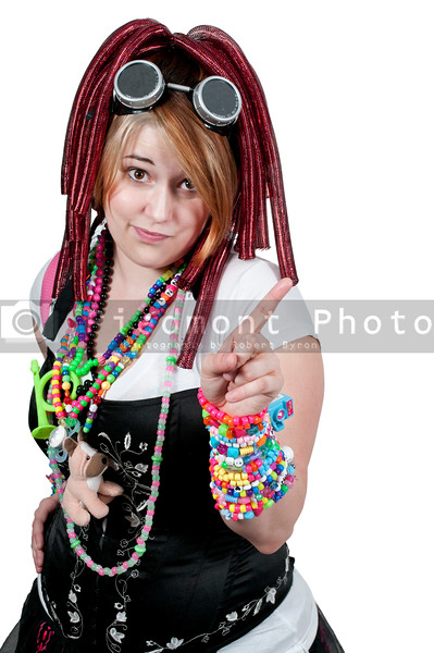 A young woman dressed to go to a rave party dance