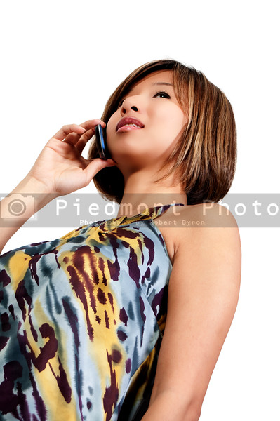 A beautiful young Asian woman using a cell phone