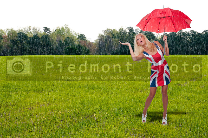 A beautiful young woman holding an umbrella in the rain
