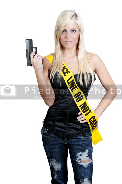 A young and beautiful woman holding a handgun