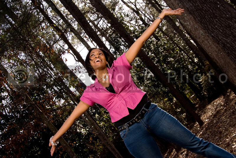 A woman with her arms outstretched expressing happiness