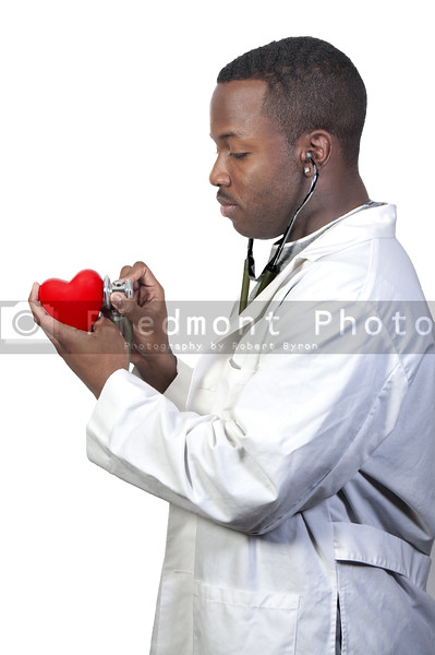 A black male African American doctor cardiologist holding a red heart