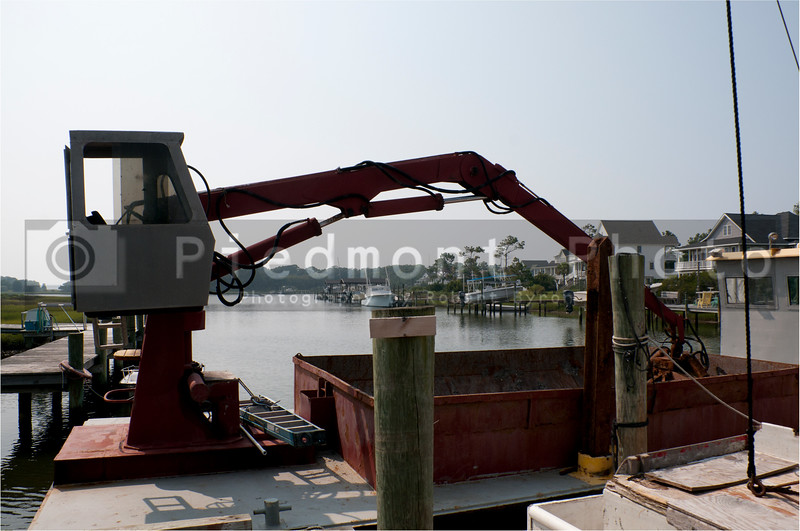 A crane used to offload fish and other seafood from commercial fishing boats