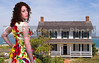 A beautiful woman at the historic home of a lighthouse keeper.