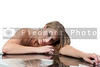 A beautiful sexy young woman stretched out over a table