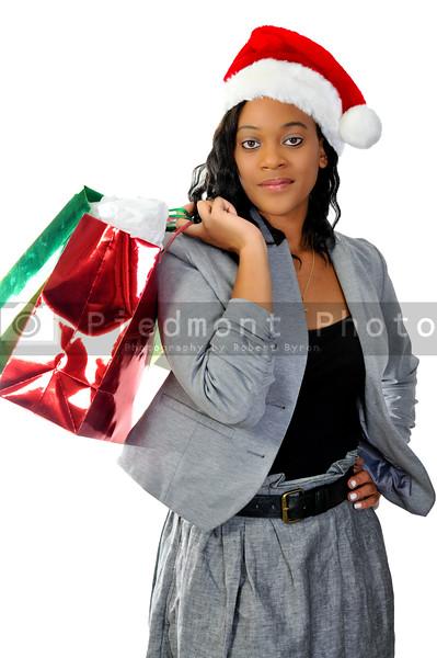 A beautiful young woman wearing a Santa hat