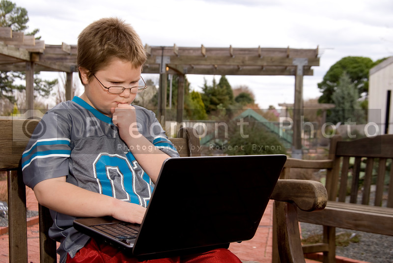 A young boy using a laptop computer