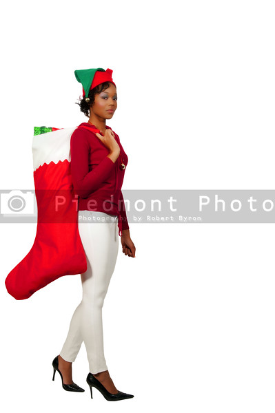 a beautiful woman elf holdin a big Christmas stocking