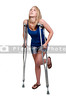 A beautiful woman using a set of medical crutches to help her walk
