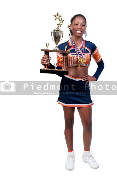 A beautiful teenage African American cheerleader holding a large trophy