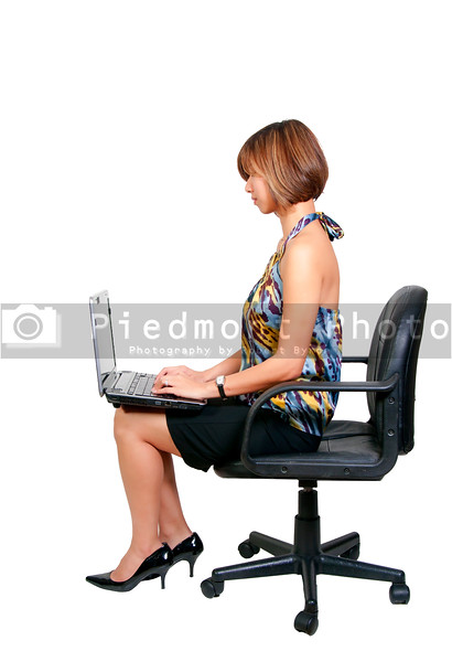 A beautiful computer savvy young Asian woman using a laptop