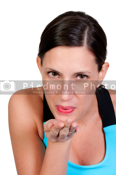 A beautiful woman blowing a kiss.