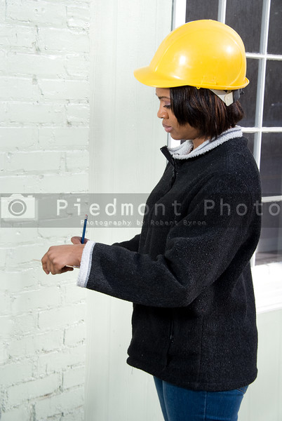 A Female Construction Inspector checking the work on a building