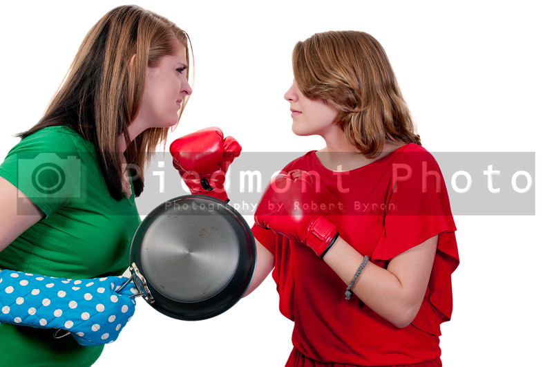 Two teenagers fighting over cooking techniques