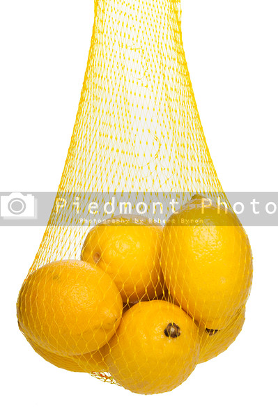 A bag full of bright yellow lemons