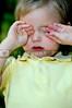 A sleepy little boy rubbing his eyes