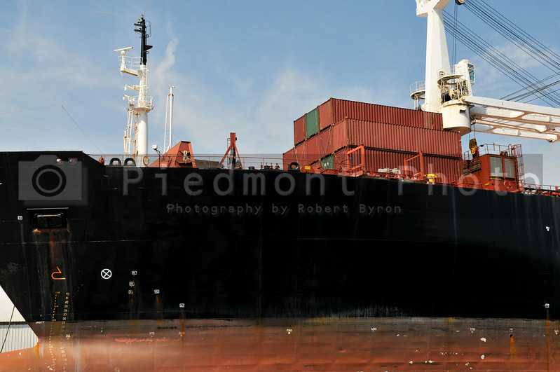A cargo ship moored at a dock