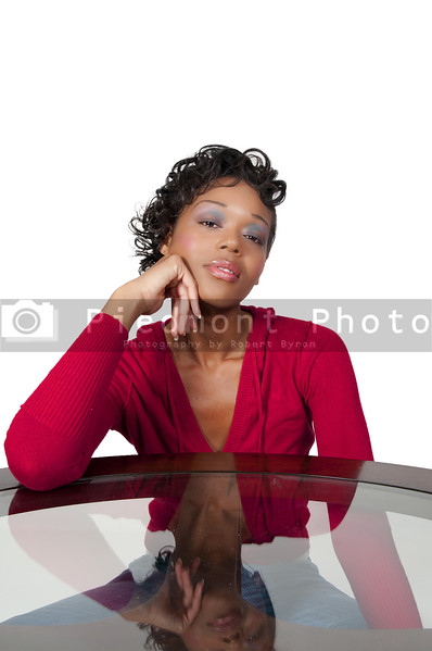 A very beautiful African American woman with a big smile thinking