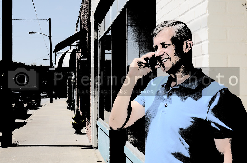 A middle aged man talking on a cell phone