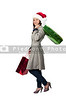 A beautiful young woman on a Christmas shopping spree