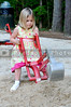 A young girl playing on a mechanical shovel