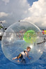 A boy rolling in an inflateable bubble
