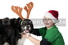 A Christmas boy and his reindeer black labrador