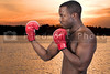 A black African American man athletic boxer with boxing gloves