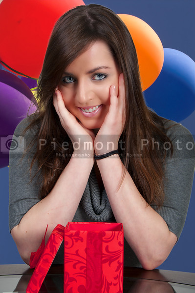A beautiful woman opening a Christmas, birthday or Valentines day present